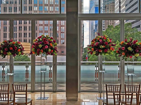 Tall, colorful floral arrangements in a hotel lobby